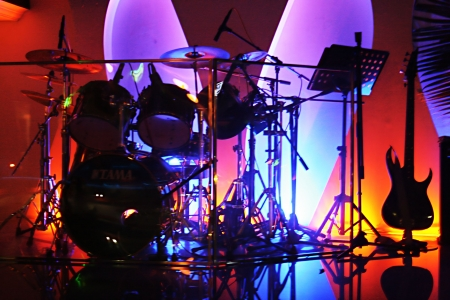 many  music  instrument  with   beautiful    colourful  lighting   photo