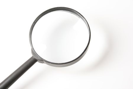 real    magnifying    glass    on   the     white     background