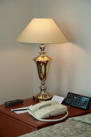 lamp   on  table with telephone  at hotel room