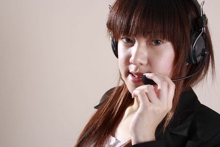 asian secretary operator conneting  customer using microphone Stock Photo - 1833244