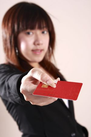Businesswoman holding  a  credit  card  in  office  photo