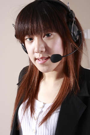 A  telephone operator in an office environment. Stock Photo - 1868440