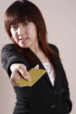Businesswoman  hold  a   gold colour  credit  card    Stock Photo - 1884466