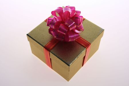 gold  color      gift     box  with   pink    ribbon
