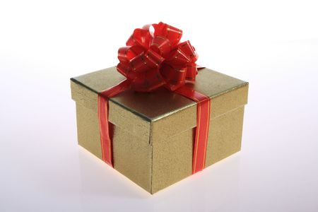 gold   color      gift     box  with  red  color   ribbon     Stock Photo