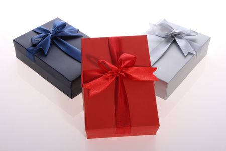 blue   , red  and silver  color   gift   box  with  beautiful  ribbon