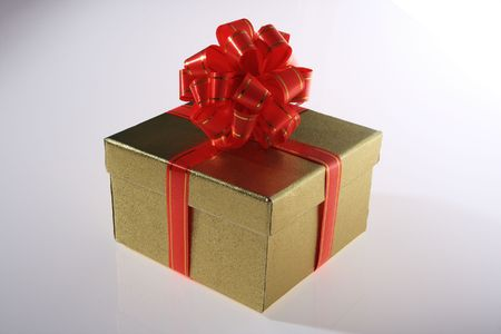 gold    color      gift     box  with  beautiful   red   ribbon