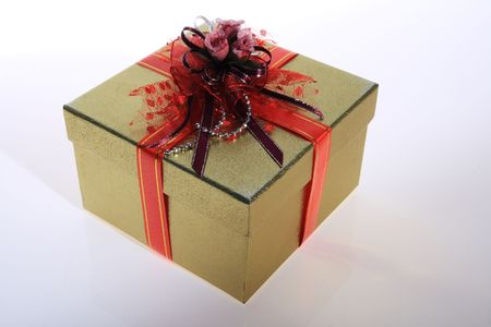 gold    color      gift     box  with  beautiful  flower