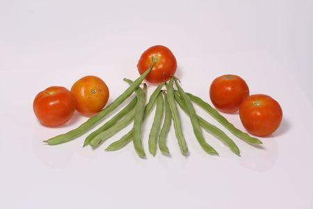 fresh   tomato  and  green   bean  on  white