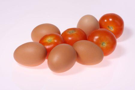 fresh eggs and   tomato  on white  background Stock Photo