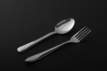 stainless  steel   Fork  and   spoon  isolated on   black  background  Stock Photo - 7427530