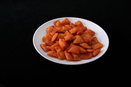 Orange   spice    snack    on   black   background     Stock Photo