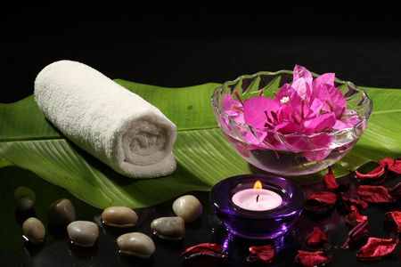 Spa     with   leafs  ,   stones   and   flower  on     white     or       black     background  Stock Photo