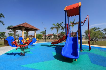 colorful    children   playground    on   park   with   blue  sky   Stock Photo