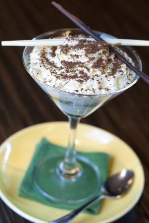 selfmade: Slice of self-made italian tiramisu dessert served in glass.