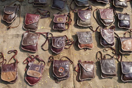 womanly: Collection of handmade leather handbags on stall at the bazaar, womanly accessories