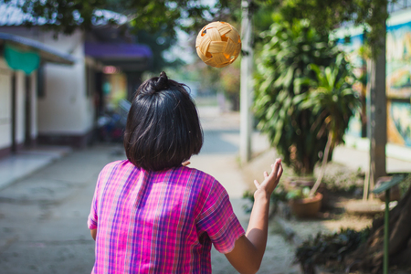 Students take exams Sepak Takraw to use head to touch the ball in Kanchanaburi Thailand.
