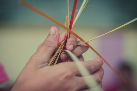 Closeup to hand of Thai students grade 4 in primary school are weaving pattern thai. 版權商用圖片