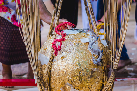Thailand tradition, An inauguration ceremony called FANG LUUK NIMIT is done to consecrate a temple. Some sacred marker spheres LUUK NIMIT need to be buried in the temple compound.