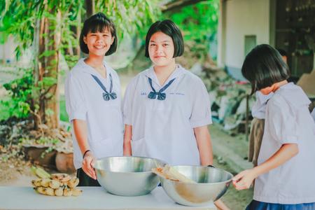 KANCHANABURI THAILAND - FEBRUARY 22 : Unidentified studentslearn to make bananas with sticky rice on february 20,2018 at Wat Krang Thong School in Kanchanaburi, Thailand