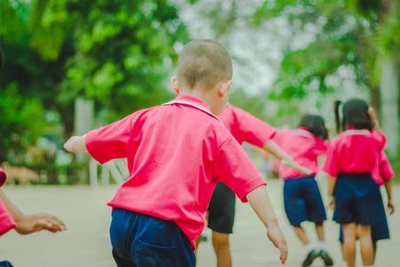 Kindergarten students are exercising in morning.