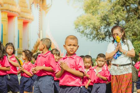 KANCHANABURI THAILAND - FEBRUARY 28 : Teachers and students of Wat Krang Thong School to make merit and candle light on Makha Bucha Day on february 28,2018 at Wat Krang Thong in Kanchanaburi, Thailand