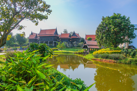 Thai traditional houses style along canal,  Mueang Mallika (historic site) in Kanchanaburi, Thailand