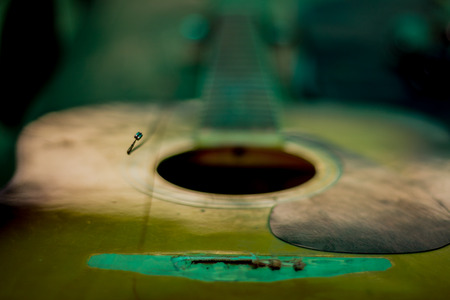 Strings missing of the old acoustic guitar in school. Stock Photo