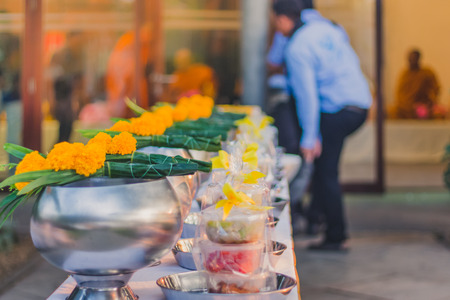 To make merit by offering food to monk ceremony in Thai wedding tradition.Selective focus on Flower bouquet.