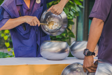 To make merit by offering food to monk ceremony in Thai wedding tradition Stock Photo