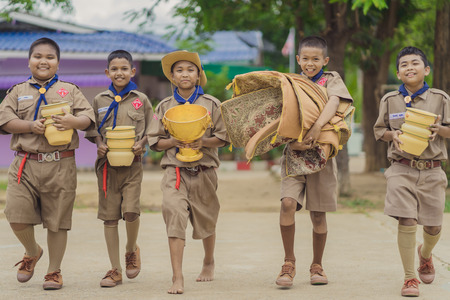 KANCHANABURI THAILAND - JUNE 13 : Unidentified Boy scouts prepare offerings for the monks in The Teachers' Day ceremony on June 13,2018 at Watkrangthongratburana school in Kanchanaburi, Thailand
