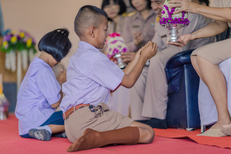 KANCHANABURI THAILAND - JUNE 14 : Unidentified students decorate pedestal tray and flower for give to teachers on Teacher Day on June 14,2018 at Watkrangthongratburana school in Kanchanaburi, Thailand