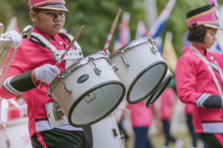 KANCHANABURI THAILAND - JULY 18 :   Thai school marching band on street, in athletic game opening day of primary student in the rain on July 18,2018 at Nongthabong School in Kanchanaburi, Thailand Editorial
