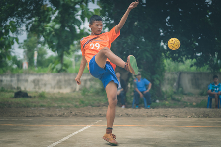 KANCHANABURI THAILAND - JULY 18 :   Unidentified students playing traditional asian sport game sepak takraw on July 18,2018 at Nongthabong School in Kanchanaburi, Thailand