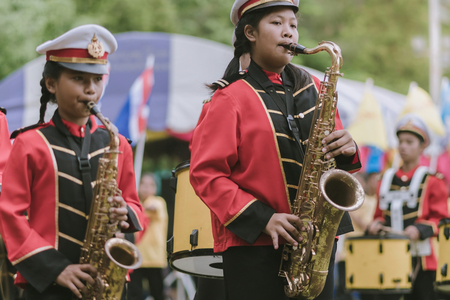 KANCHANABURI THAILAND - JULY 18 :   Thai school marching band on street, in athletic game opening day of primary student in the rain on July 18,2018 at Nongthabong School in Kanchanaburi, Thailand Imagens - 124658615