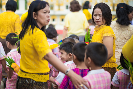 KANCHANABURI THAILAND - JULY 26 : Unidentified Teachers and students together to make merit and candle light on Buddhist lent day on July 26,2018 at Wat Krang Thong in Kanchanaburi, Thailand