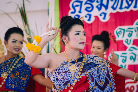 KANCHANABURI THAILAND - SEPTEMBER 28 :   Unidentified female teachers perform Thai dance on stage for retirement on September 28,2018 at Watkrangthongratburana school in Kanchanaburi, Thailand