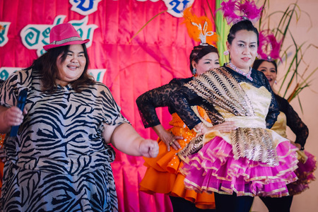 KANCHANABURI THAILAND - SEPTEMBER 28 :   Unidentiffied female teachers perform Thai dance on stage for retirement on September 28,2018 at Watkrangthongratburana school in Kanchanaburi, Thailand Editorial
