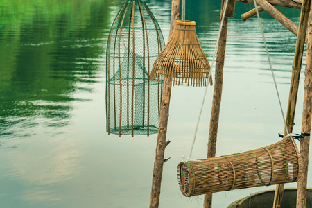 Ancient bamboo fish trap equipment of countryside, Thailand Stock Photo