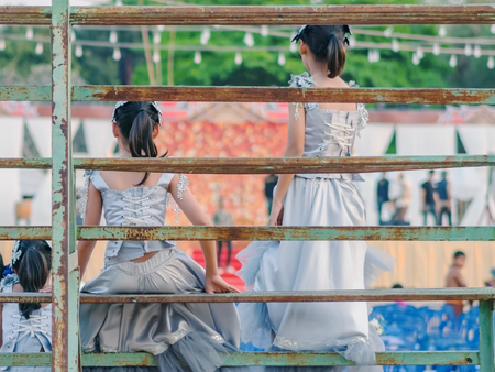 Young girls sit on the grandstand to wait for the stage performance. 版權商用圖片