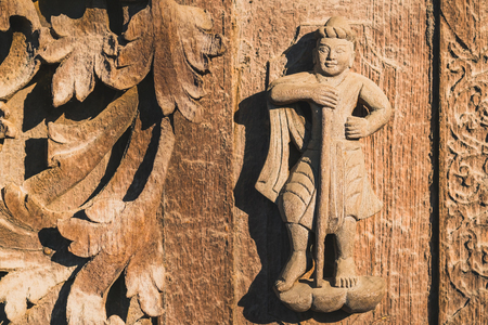 Archaeological, Close Up of carved art figures on old wood carvings on the wall temple at Shwe Nan Daw Kyaung (Golden Palace Monastery) in Mandalay, Myanmar