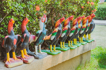 Colorful of many rooster statues at King Naresuan Monument in Kanchanaburi, Thailand.