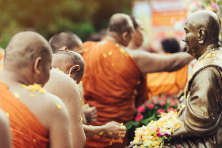 Group of Monks bath Buddha sculputer purify body and spirit in Songkran festival, Thailand