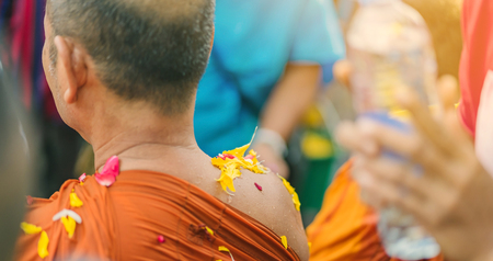 People pouring water to Buddhist Monk and gives blessing in Thailand Songkran annual festival in Buddhist temple. 스톡 콘텐츠