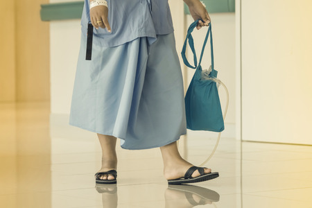 Female urinary tract patients walking for exercise and rest alone in the hospital 写真素材