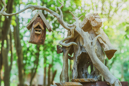 Hand made wooden bird house nest  in public Park , hand wood shelter for birds
