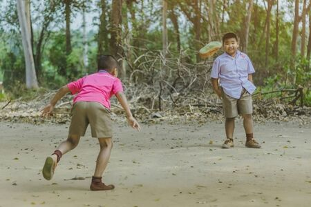 KANCHANABURI THAILAND - FEBRUARY 2 : Unidentified Students enjoy playing old football with their friends on the ground in school on February 2, 2018 at Watkrangthongratburana school in Kanchanaburi, Thailand