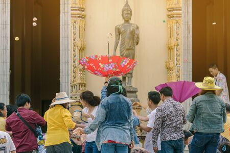 RATCHABURI -THAILAND-APRIL 14: Unidentified people join the ordination enjoy compete the coins throw away from the new monk at temple on April 14,2019 in Ratchaburi, Thailand.