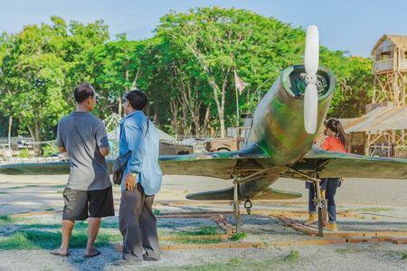 Tourists watch Japanese replica fighter planes during World War II at World War ll Bridge Project near The Bridge on the River Kwai in Kanchanaburi Thailand.