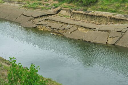 Irrigation canal or irrigation channel in concrete wall Send water from the reservoir to the agricultural area of the farmer that is dry in the rainy season of Thailand. Environmental disaster in agriculture